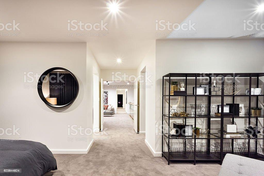 Hallway through the luxury house illuminated with lights stock photo