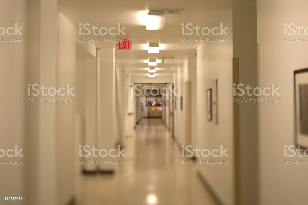 Hallway with exit sign stock photo