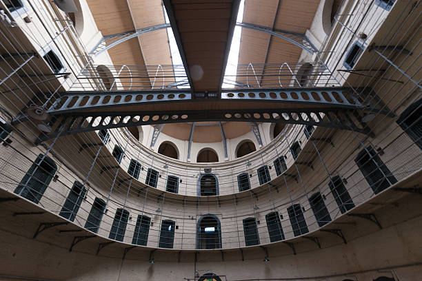 Hallways and metal bars of an empty prison stock photo