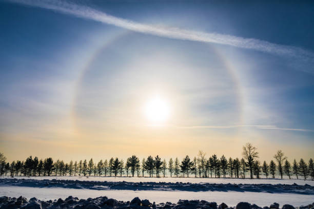 Halo around sun on blue sky in winter time stock photo