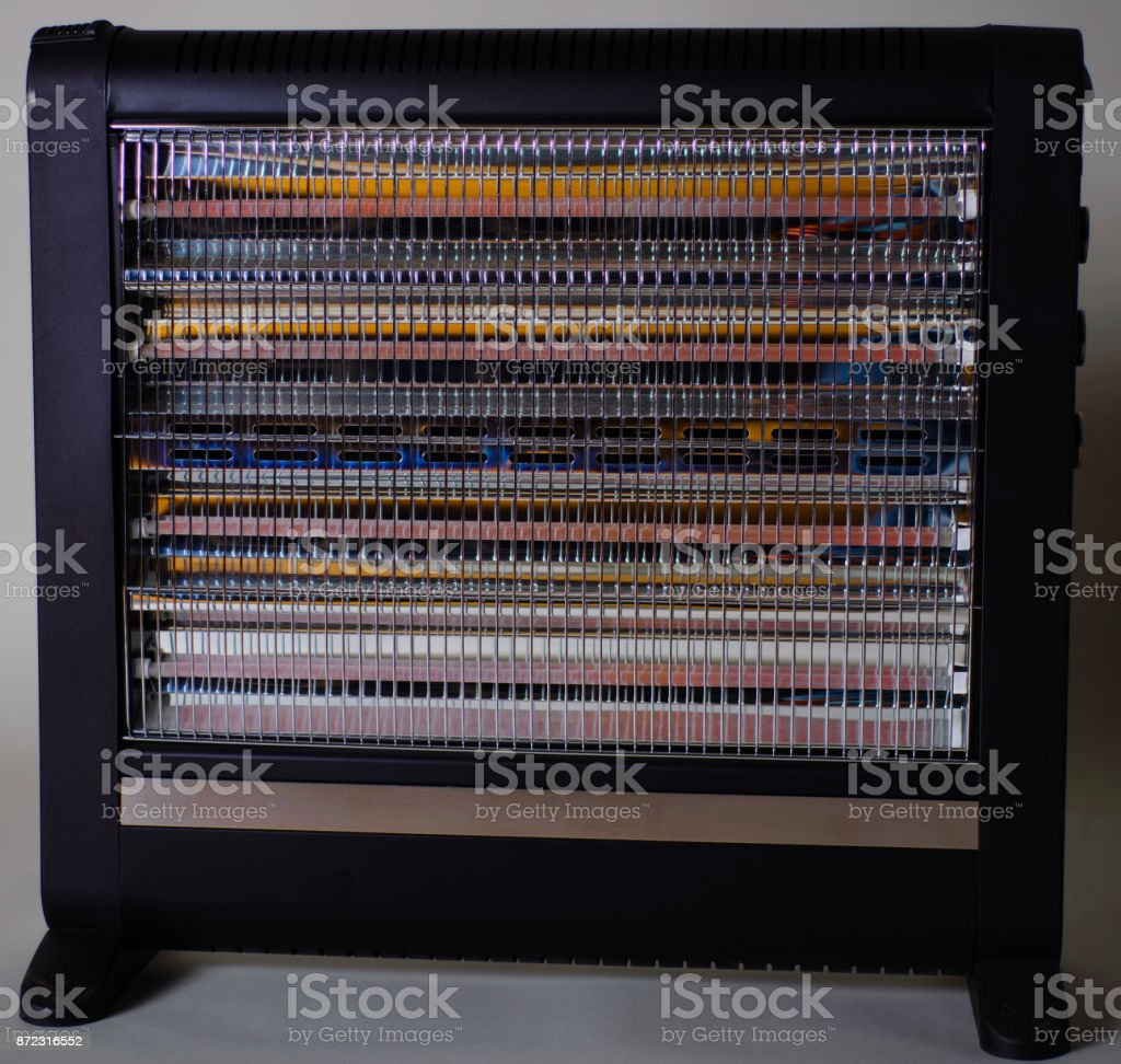 Halogen or infra heater in action against gray background stock photo