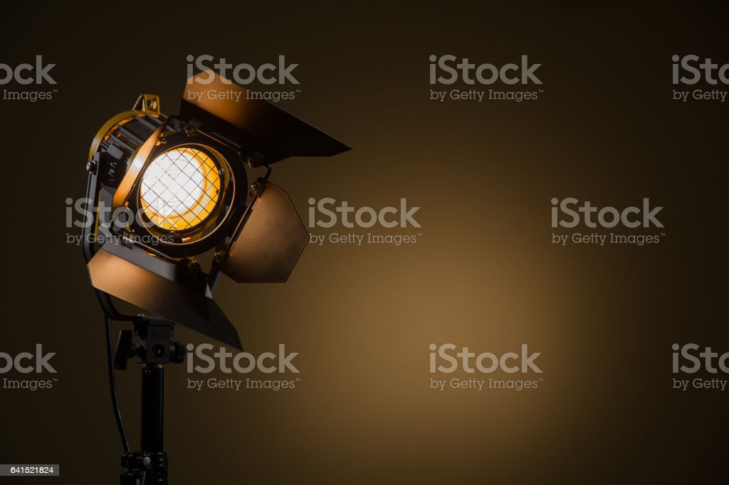 Halogen spotlight with a Fresnel lens. Spot light on the wall. TV, video, photo, shooting stock photo