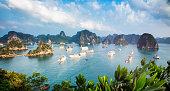 Halong Bay Vietnam panorama at sunset with anchored ships