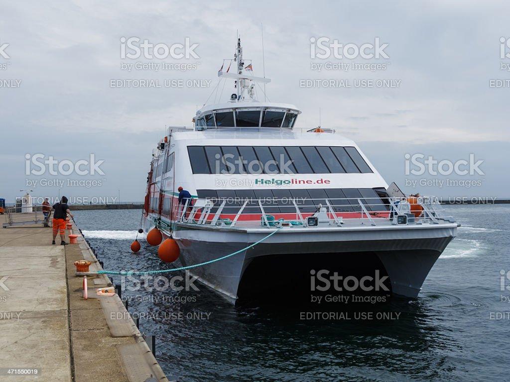 Halunder Jet catamaran on its way to Helgoland harbour stock photo