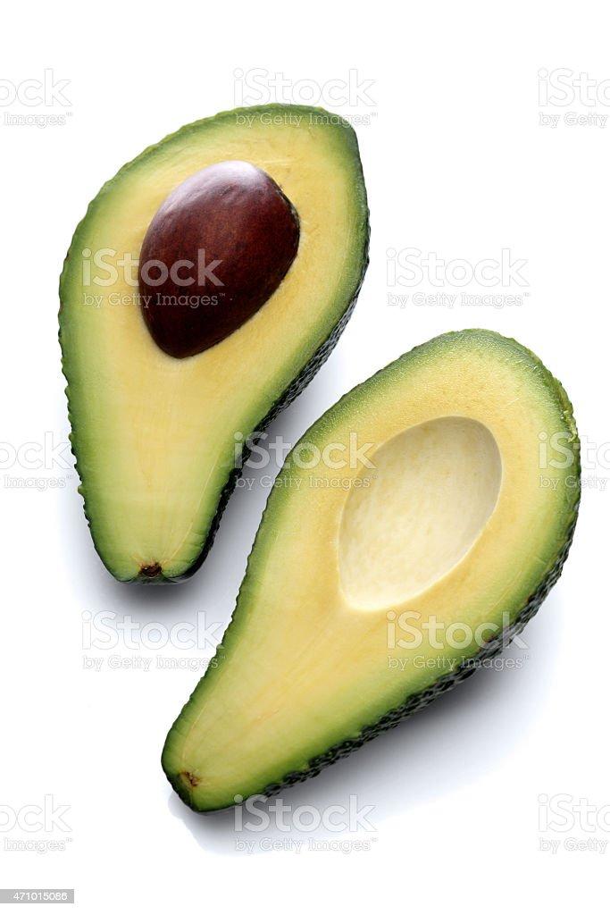 Halved avocado on white background stock photo