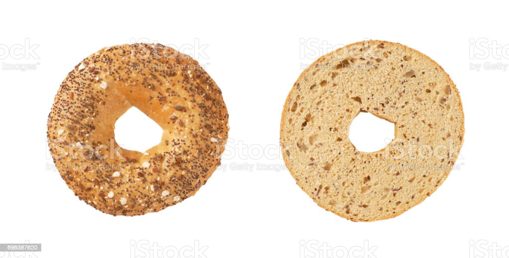 halved bagel with seeds stock photo