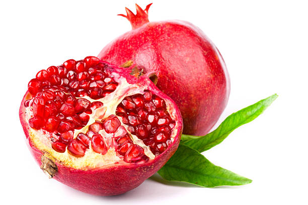 Halved pomegranate with interior view of seeds stock photo