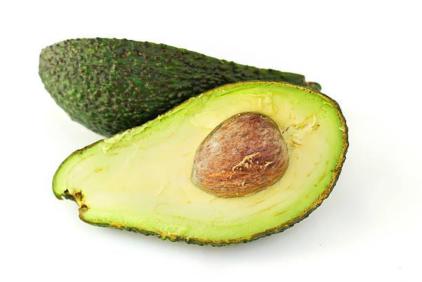 Halves of avocado isolated on white stock photo