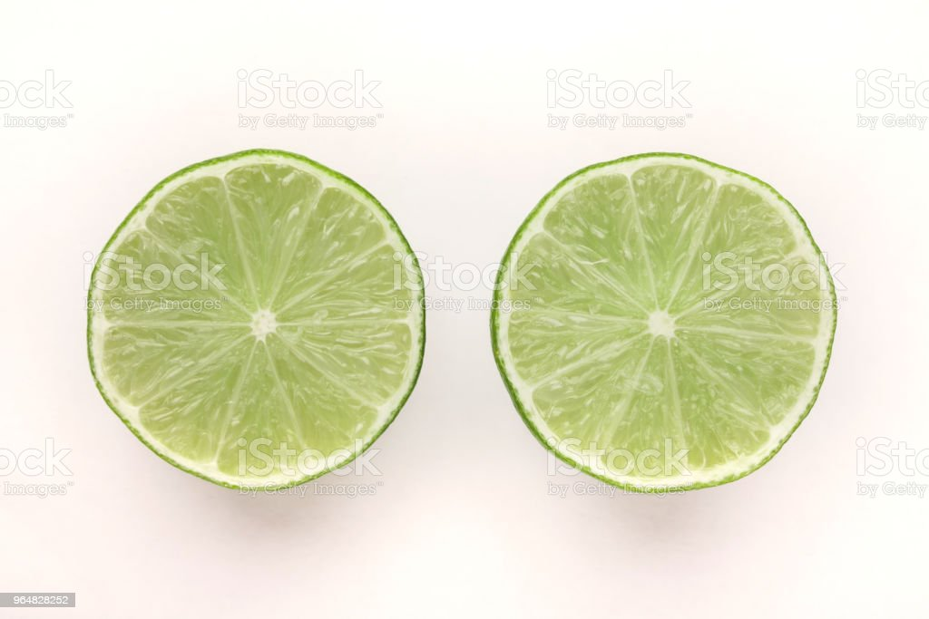 Halves of lime isolated on white background royalty-free stock photo
