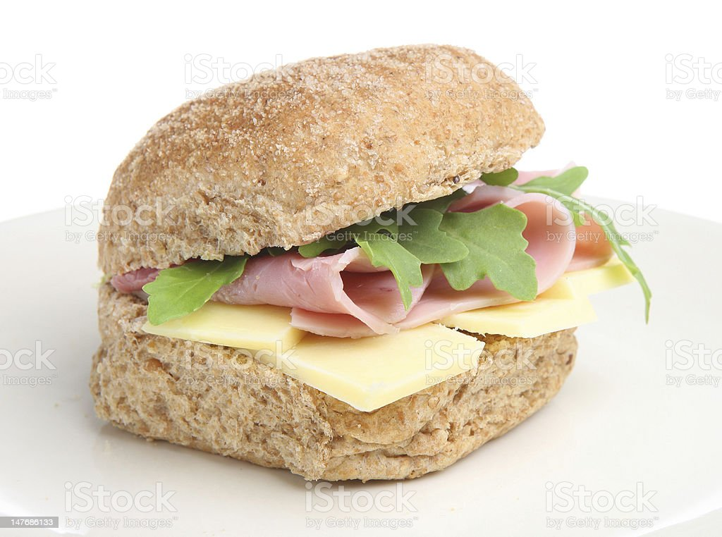 Ham and cheese sandwich of wheat roll isolated on white stock photo