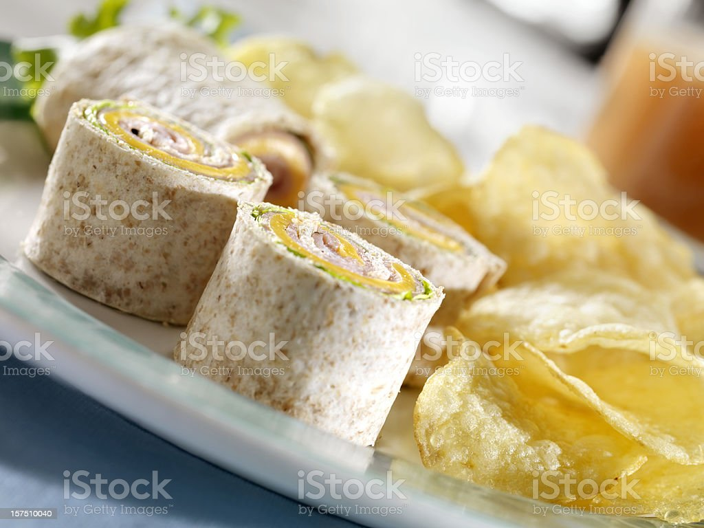 Ham and Cheese Wrap with Potato Chips royalty-free stock photo