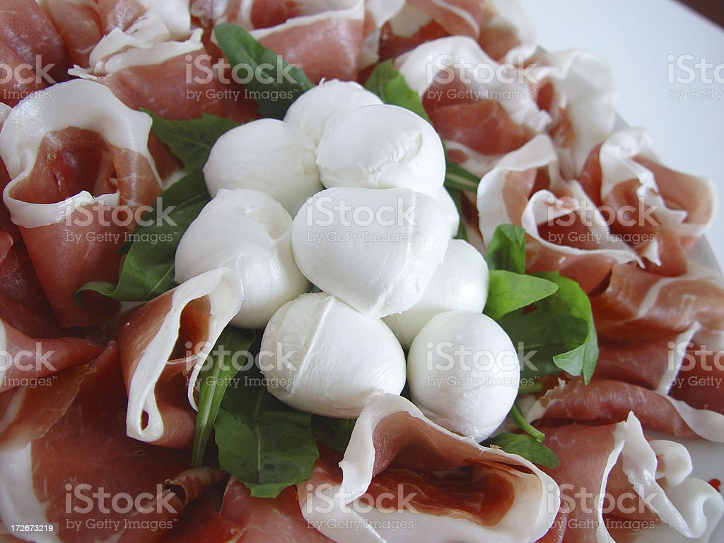 Ham and Mozzarella Cheese with Arugula leaves stock photo