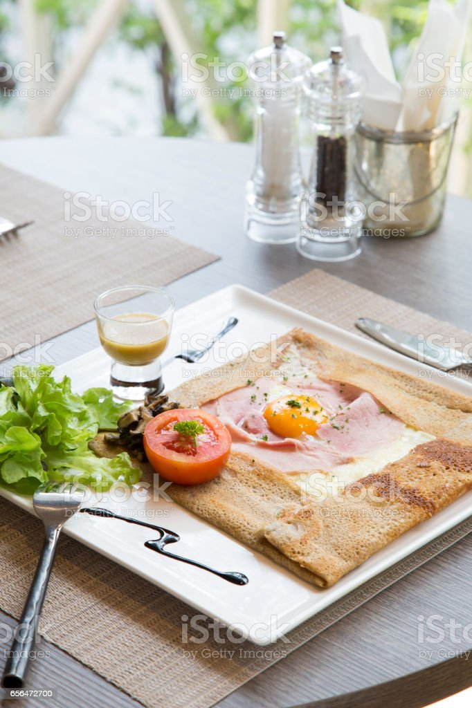Ham cheese and egg crepe on table – Foto