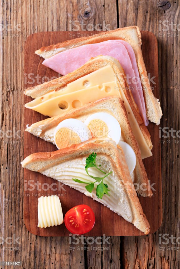 Ham, cheese and egg sandwiches royalty-free stock photo