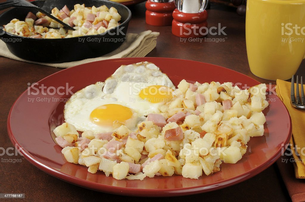 Ham eggs and hash browns royalty-free stock photo
