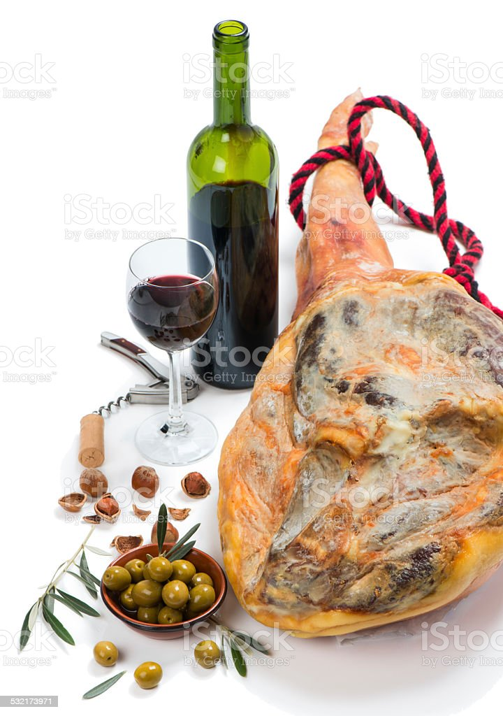 Ham, olives, wine and nuts stock photo