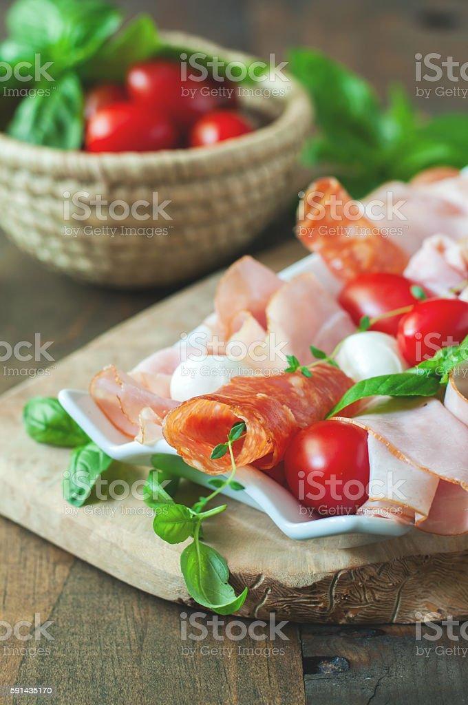 Ham, salami, antipasto, mozzarella and bocconcini soft cheese stock photo