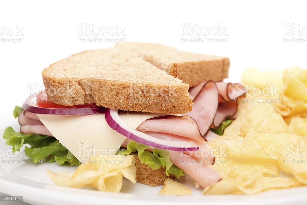 Ham sandwich platter with potato chips royalty-free stock photo