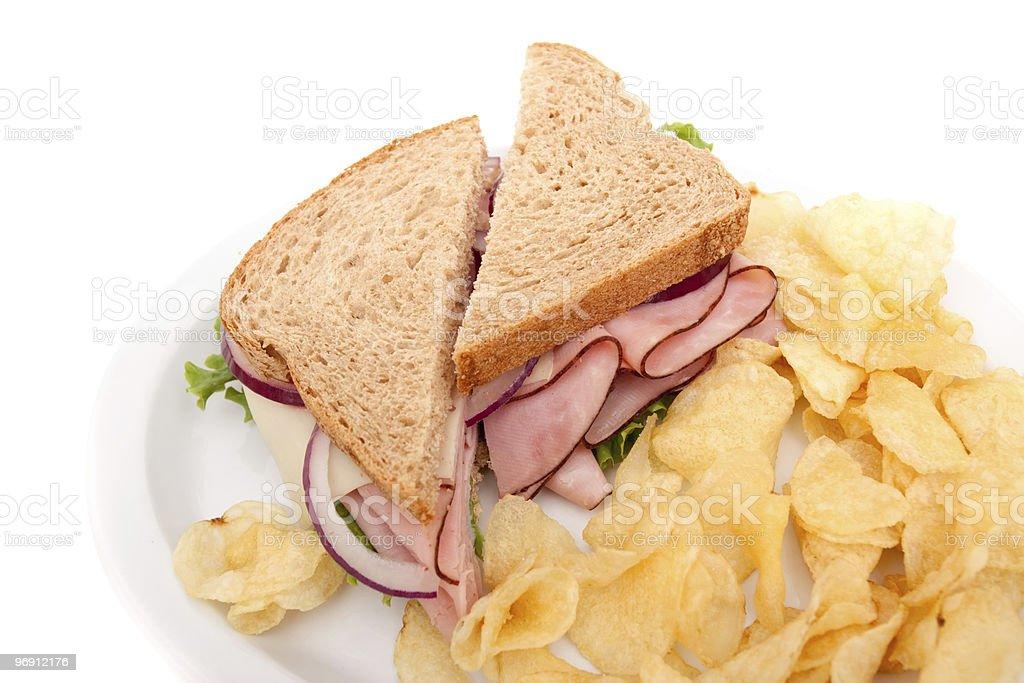 Ham sandwich platter with potato chips royalty-free stock photo