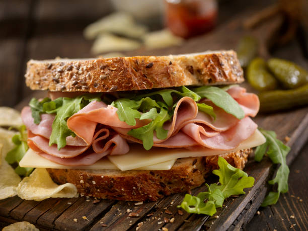 Ham, Swiss and Arugula Sandwich stock photo
