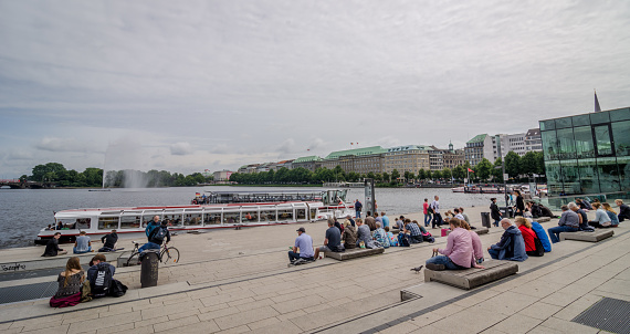 Hamburg Alster Lake with People sitting on a benches