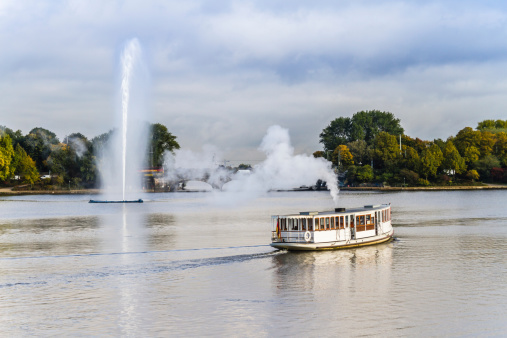 Hamburg Alster with fountain and steam-boat
