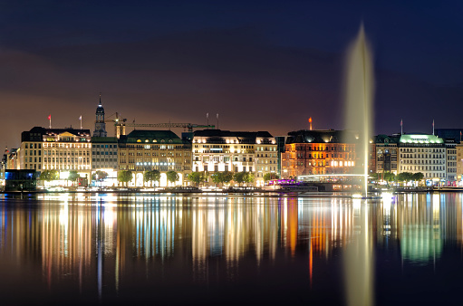 Hamburg Binnenalster at night in Germany with Alsterhaus and fountain in the background photographed on 2017.07.09