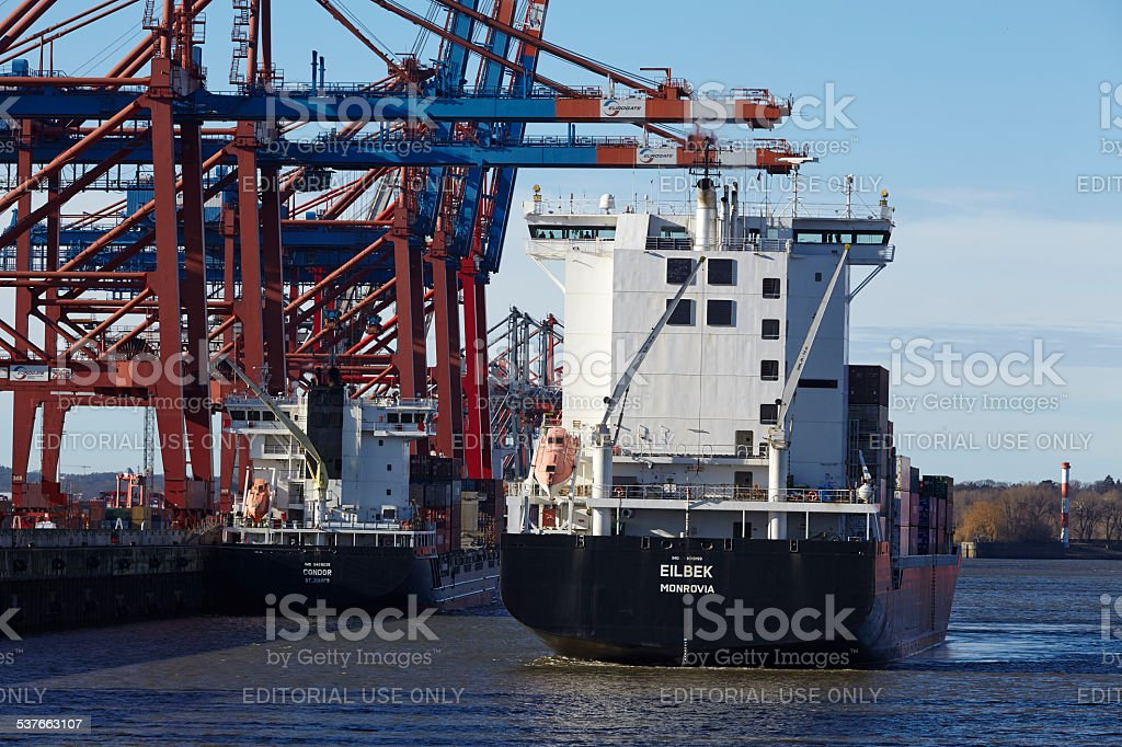 Hamburg - Container vessel arrives at the port Waltershof stock photo