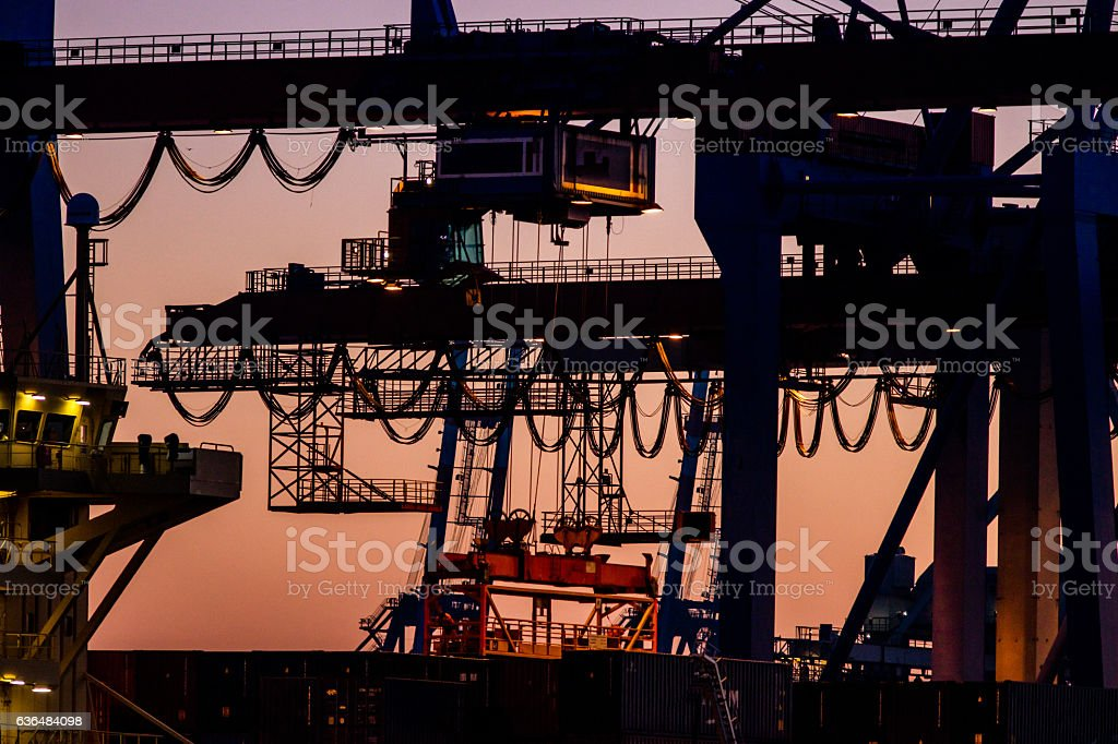 Hamburg harbor cranes stock photo