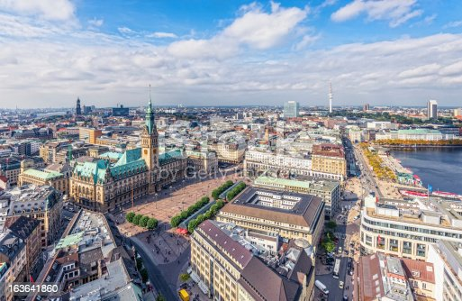 Aerial panoramic view on Hamburg´s landmarks -- the harbour, the St. Michaelis Church, the Town Hall, TV Tover and Inner Alster -- on beautiful early autumn day.