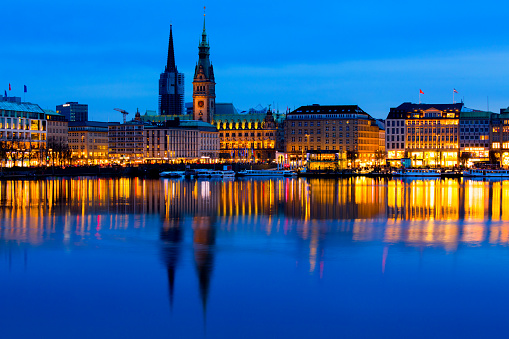 Hamburg skyline with reflection in Alster lake.