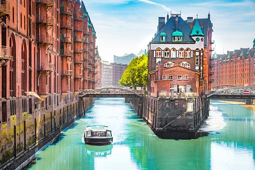 Hamburg Speicherstadt with sightseeing tour boat in summer, Germany