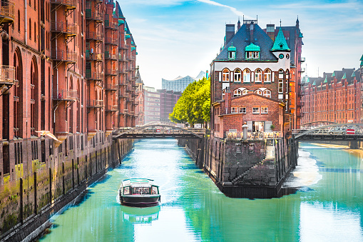Hamburg Speicherstadt with sightseeing tour boat in summer, Germany