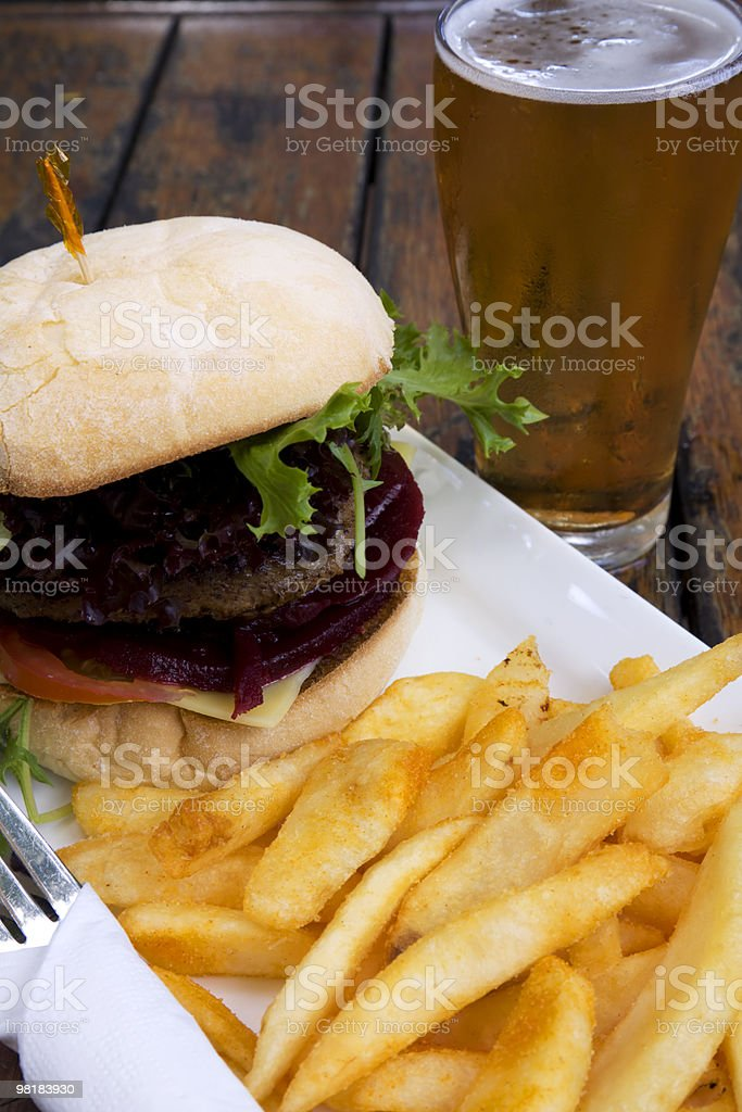 hamburger and chips with beer stock photo