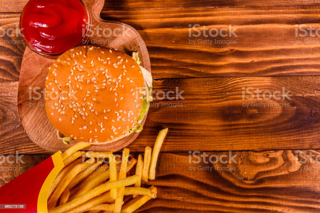Hamburger and french fries on wooden table. Top view zbiór zdjęć royalty-free
