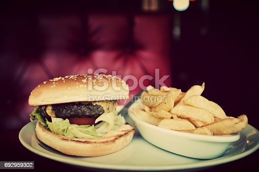 istock Hamburger and french fries plate in american food restaurant 692959302