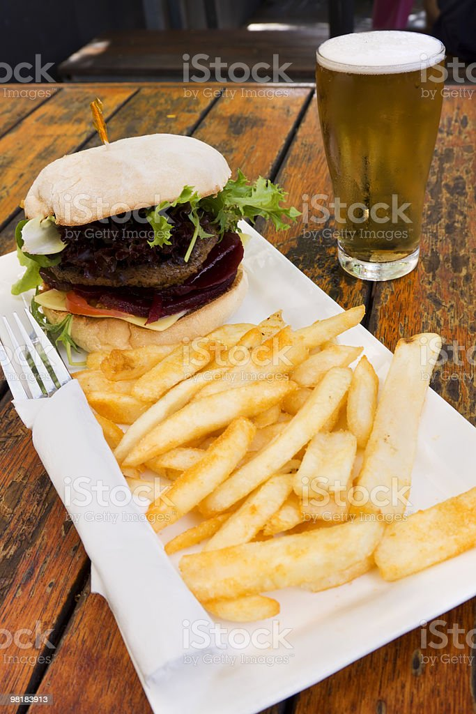Hamburger chips and beer stock photo