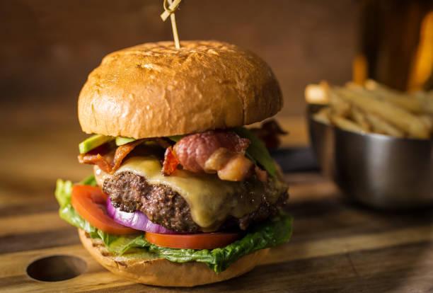 Hamburger Fries and Beer Bacon burger with cheddar cheese and beer. bacon cheeseburger stock pictures, royalty-free photos & images