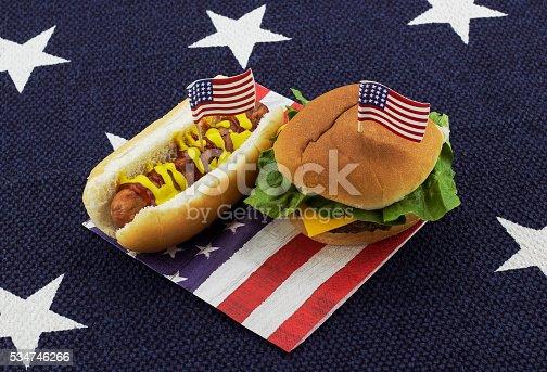 534317162istockphoto Hamburger & Hotdog on an American flag napkin with toothpick 534746266