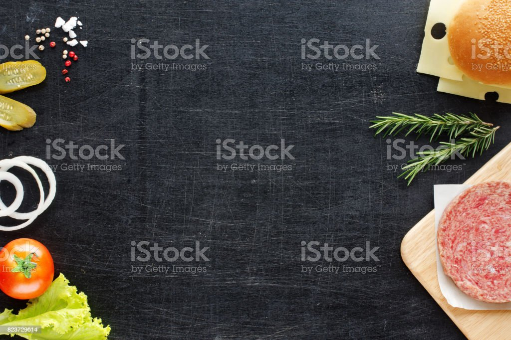 Hamburger ingredients on a black background. Space for text. stock photo