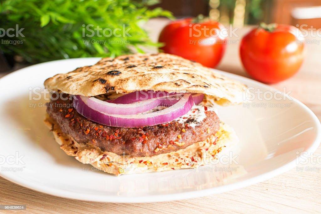 Hamburger made in Serbia in pita bread with fresh salad royalty-free stock photo