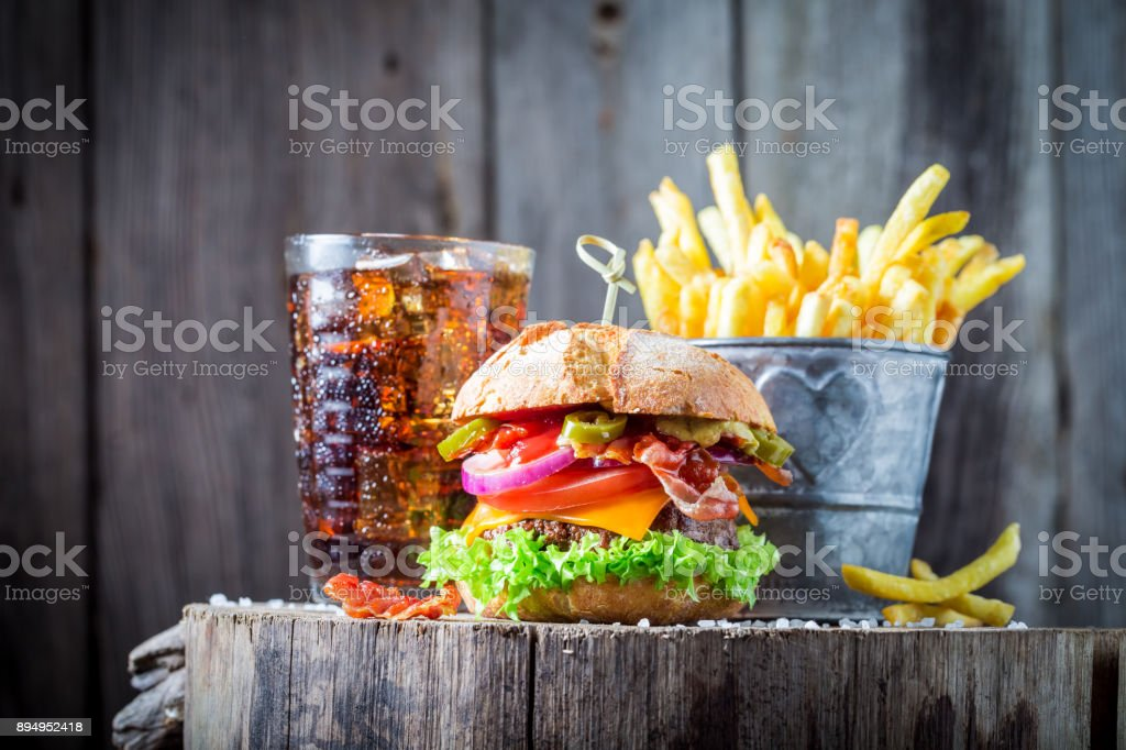 Hamburger made of onion, tomato and lettuce served with chips stock photo