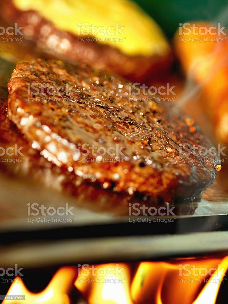 Hamburger on a Camping Grill royalty-free stock photo