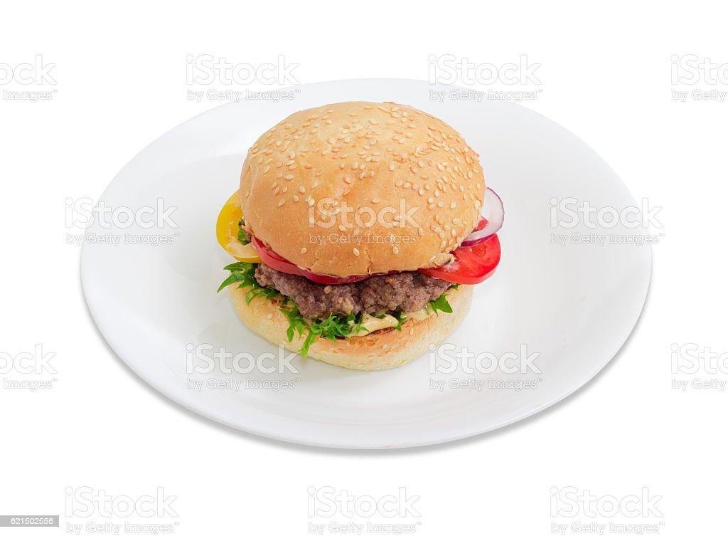 Hamburger on a white dish on a light background Lizenzfreies stock-foto