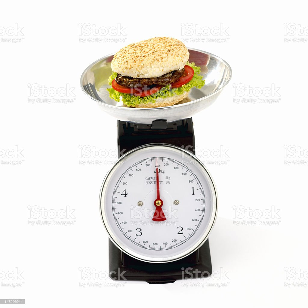 Hamburger on kitchen scale royalty-free stock photo