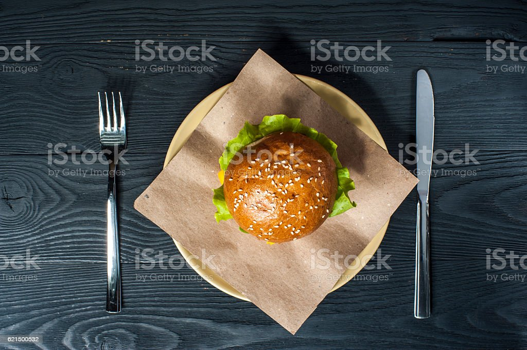 Hamburger on white plate with fork and knife Lizenzfreies stock-foto