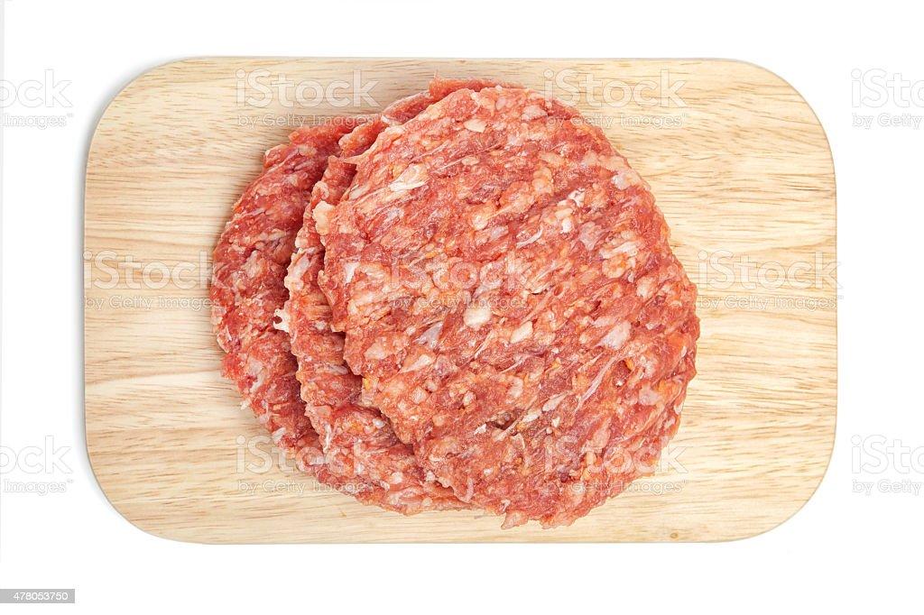 Hamburger, raw meat on chopping board stock photo