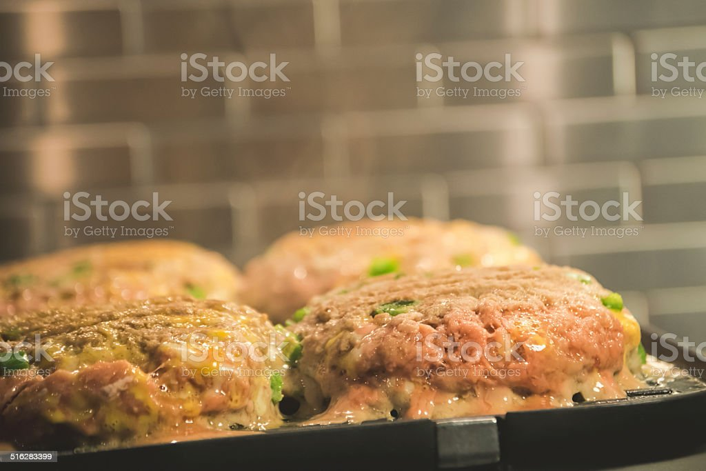 Hamburger Turkey Meat on Grill stock photo