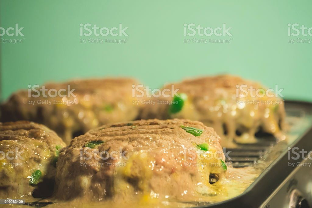 Hamburger Turkey Meat on Grill stock photo