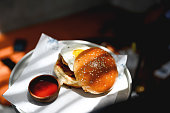 Serving hamburger with egg and ketchup on a serving tray, Nikon Z7